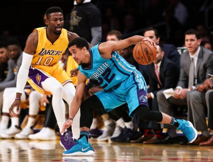 Los Angeles Lakers forward and former Cal Poly star David Nwaba defends Charlotte Hornets guard Brian Roberts, right, during the second half of an NBA basketball game Tuesday in Los Angeles. Ringo H.W. Chiu AP