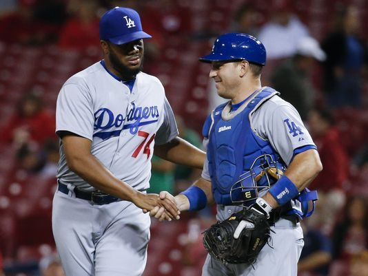Los Angeles Dodgers pitcher Kenley Jansen (74) celebrates with  catcher A.J. Ellis after a baseball game against the Cincinnati Reds on Tuesday, Aug. 25, 2015 (AP photo/ John Minchillo)