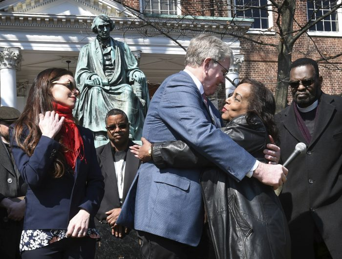 Lynne Jackson, a descendant of Dred Scott, right, hugs Charles Taney III, a descendant of U.S. Supreme Court Chief Justice Roger Taney on the 160th anniversary of the Dred Scott decision in front of the Maryland State House, Monday, March 6, 2017, in Annapolis, Md. On March 6, 1857, the U.S. Supreme Court, in Dred Scott v. Sandford, ruled 7-2 that Scott, a slave, was not an American citizen and therefore could not sue for his freedom in federal court. (Kenneth K. Lam/The Baltimore Sun via AP)