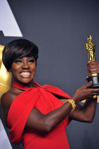 "Viola Davis holding up her well-earned Oscar for Best Supporting Actress in ""Fences."" (Photo Courtesy: Valerie Goodloe)"