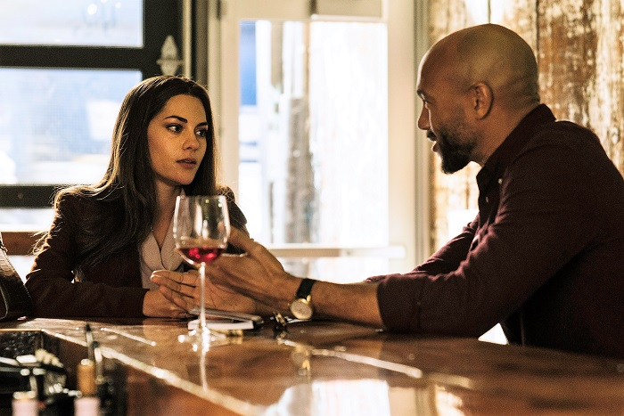 "Stephen Bishop pictured in a scene with Inbar Lavi as ""Maddie"", a professional con artist in Bravo's dark comedy series ""Imposters"""