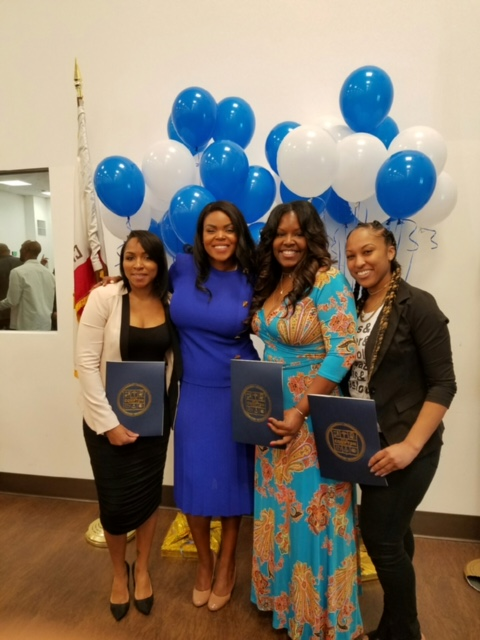 Enjonette Baker with the Mayor of Compton, Aja Brown, Receiving an Certificate of Service for her Leadership and Dedication to the City of Compton . (courtesy photo)