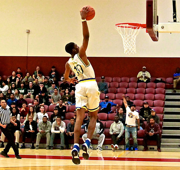 Junior Kevin Ebiriekwe elevates for a slam dunk (E. Mesiyah McGinnis)