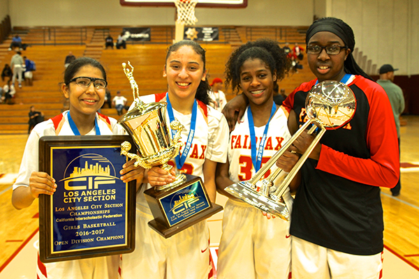 Members of the Fairfax gils basketball team pose with the Sparks' WNBA Championship Trophy (E. Mesiayh McGinnis)