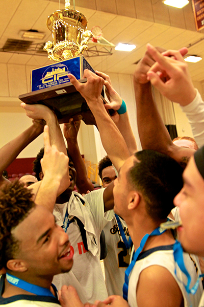 Members of the Birmingham boys basketball team holding up the trophy. (E Mesiyah McGinnis)
