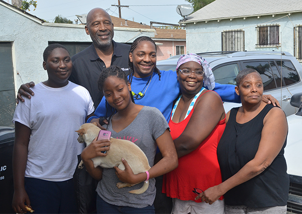 (left to right) Jaylin Rollins, Anaiya Rollins, James Worthy, Donte Adams, Nekia Gilmore-Jones, and Jessica Gilmore (Amanda Scurlock/L.A. Sentinel)