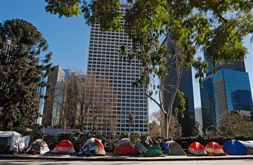 "Tents from a homeless encampment line a street in downtown Los Angeles on Tuesday, Jan. 26, 2016. Some 7,000 volunteers will fan out as part of a three-night effort to count homeless people in most of Los Angeles County. Naomi Goldman, a spokeswoman of the organizer the Los Angeles Homeless Services Authority, said the goal is to ""paint a picture about the state of homelessness."" (AP Photo/Richard Vogel)"