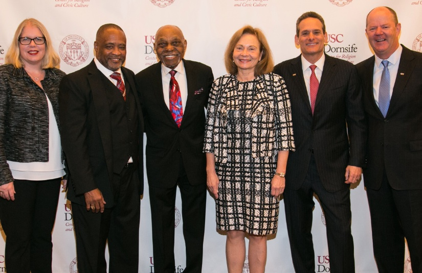 """From left are Brie Loskota, executive director, USC Center for Religion and Culture; Rev. Mark Whitlock and Rev. Dr. Cecil """"Chip"""" Murray, USC Murray Center for Civic Engagement; Ellen Alemany, president/CEO, CIT/OneWest; Steve Salk, president, CIT Consumer Banking; and Rick Lieber, senior vice president, CIT."""