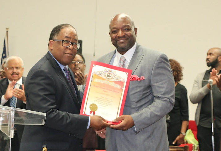 Supv. Mark Ridley-Thomas presents a commendation to Pastor Anthony Williams of 88th St. Remple COGIC.