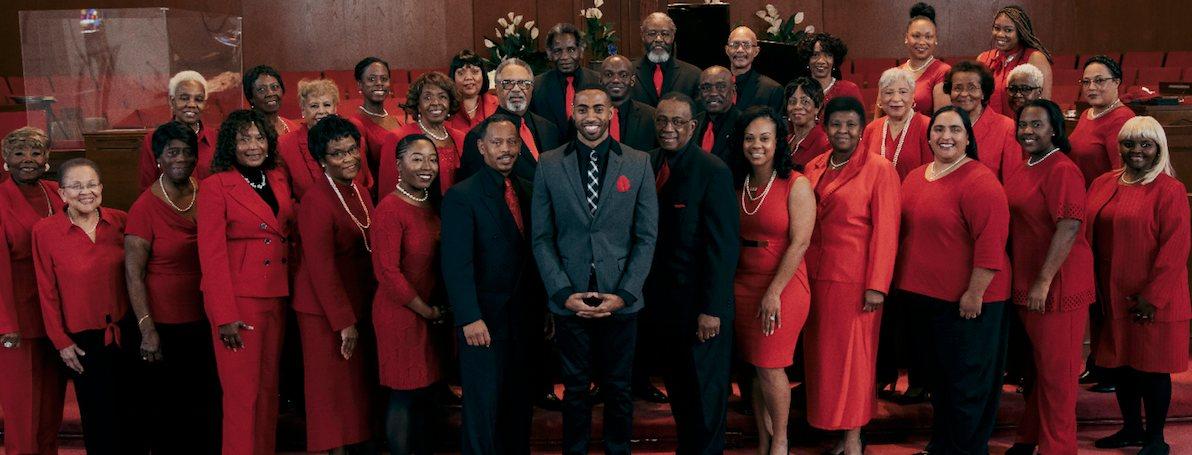 Director Roland Hamilton (center) with the Trinity Mass  Choir.