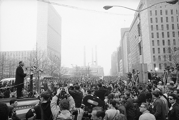 "Dr. Martin Luther King, Jr., leader of the Vietnam war protest demonstration which attracted 125,000 voices a repeated demand to ""Stop the bombing"" in New York, April 15, 1967. He said, ""I think this is just the beginning of a massive outpouring of dissent."" (AP Photo)"