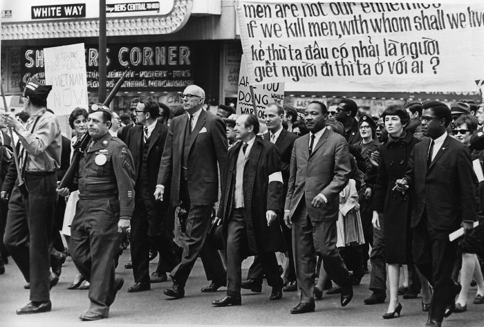 Leading the march against the Vietnam conflict are Dr. Benjamin Spock, tall, white-haired man, and Dr. Martin Luther King Jr., third from right, in a parade on State St. in Chicago, Ill., March 25, 1967.  Dr. Spock is co-chairman of the National Committee for Sane Nuclear Policy.  (AP Photo)