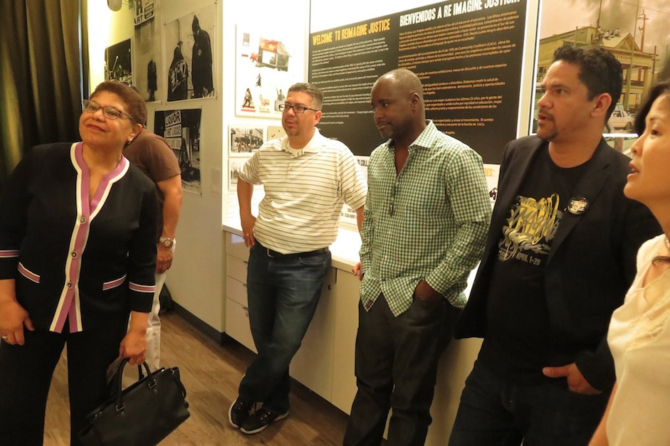 "Congresswoman Karen Bass (left), L.A. Councilmember Marqueece Harris-Dawson (2nd from right) and Community Coalition CEO/ president Alberto Retana (right) tour the ""Re-Imagine Justice"" exhibit on April 1. (Courtesy Photo)"