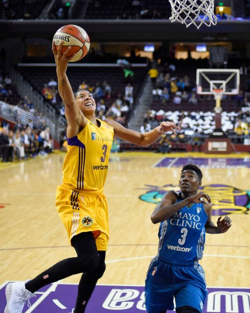 Los Angeles Sparks' forward Candace Parker shoots as Minnesota Lynx forward Natasha Howard defends during the first half in Game 3 of the WNBA Finals on Friday, Oct. 14, 2016.