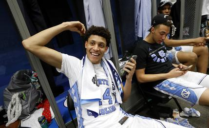 North Carolina forward Justin Jackson talks on his cell phone in the locker room after the championship game against Gonzaga at the Final Four NCAA college basketball tournament, Tuesday, April 4, 2017, in Glendale, Ariz. North Carolina 71-65. (AP Photo/Mark Humphrey)