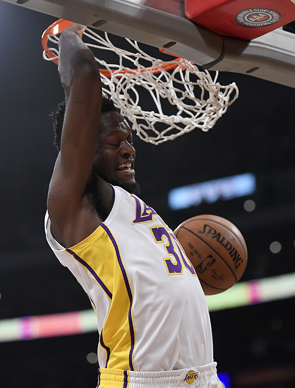 e383c3316ed Los Angeles Lakers forward Julius Randle dunks during the first half of a  basketball game against the Atlanta Hawks, Sunday, Jan. 7, 2018, in Los  Angeles.