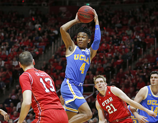 6ac004c4967 UCLA guard Jaylen Hands (4) passes the ball as Utah s David Collette (13)  and Tyler Rawson (21) defend during the first half of an NCAA college  basketball ...
