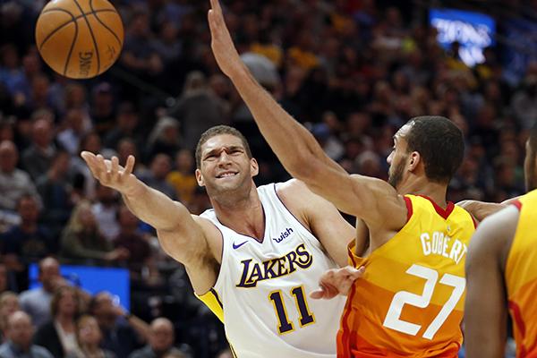 5a67bcb2ff5 Los Angeles Lakers center Brook Lopez (11) lays the ball up as Utah Jazz  center Rudy Gobert (27) defends. (AP Photo Rick Bowmer)