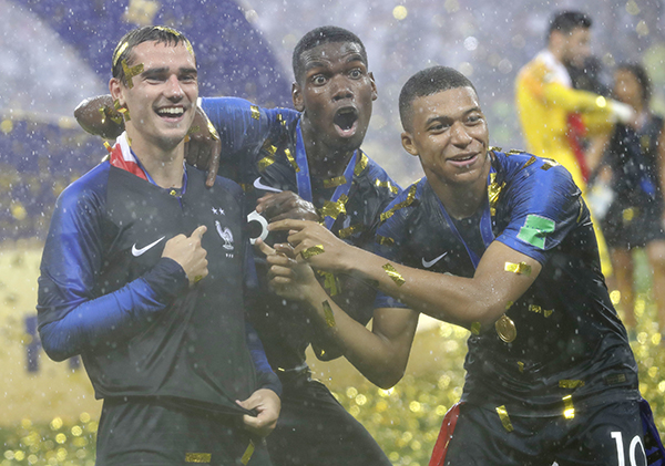 31fb913010b France's Antoine Griezmann, points to two stars on his jersey indicating  two world cup wins, as he celebrates with Paul Pogba and Kylian Mbappe  after the ...