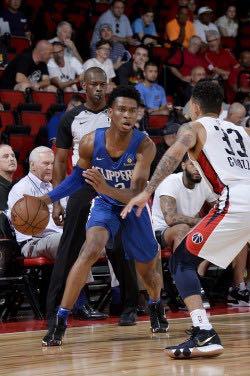 5e5ec54439f Clippers' rookies (L-R) Shai Gilgeous-Alexander battles against a  Washington Wizards' defender at NBA Summer League in Las Vegas, NV.