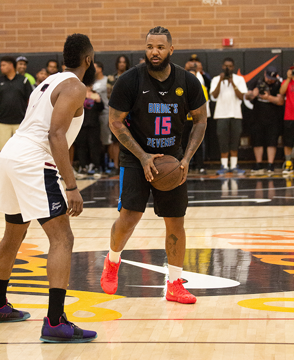 6f1fe55b919 Rapper The Game holds the ball for Birdie's Revenge being defended by NBA  MVP James Harden at the Drew League. (Jada Stokes/L.A. Sentinel)