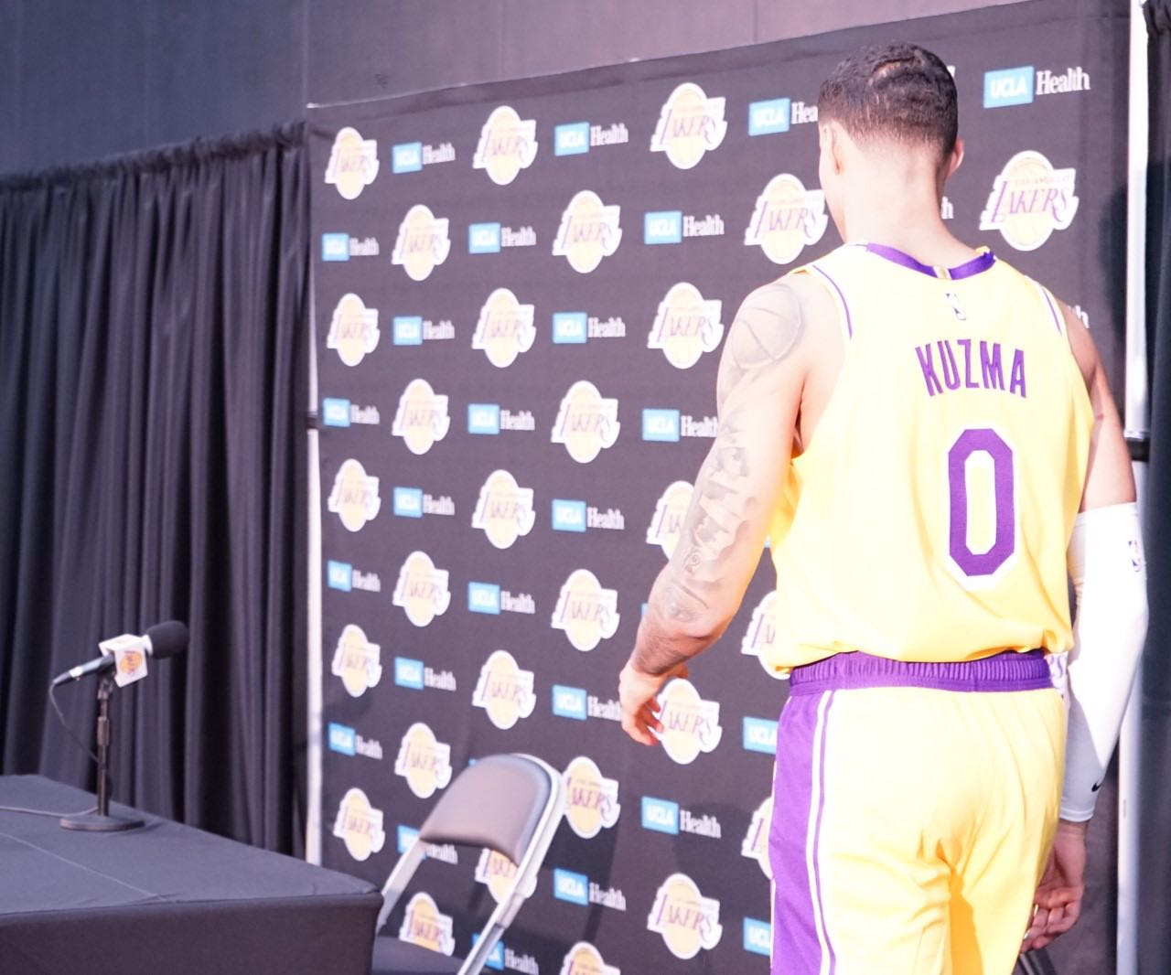 fe845a085548b Kyle Kuzma walks to the podium at Lakers media day at the UCLA Health  Training Facility in El Segundo, Calf. (Photo by Lauren A. Jones/L.A.  Sentinel)