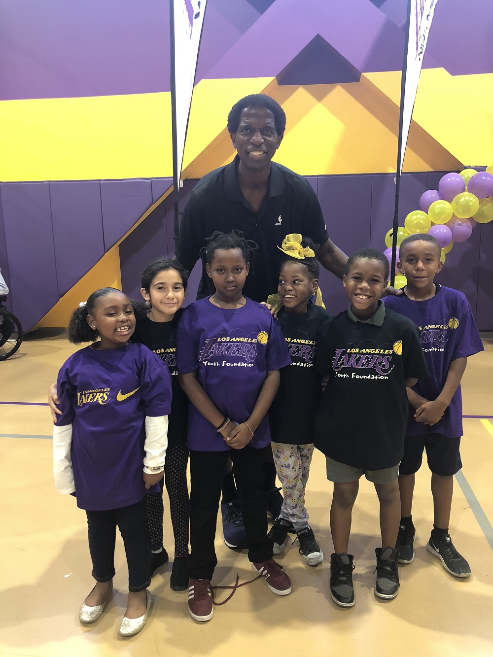 af02e2faa Laker alumnus A.C. Green and children from the Union Rescue Mission pose  for a photo at the Lakers Youth Foundation court dedication in downtown Los  Angeles ...