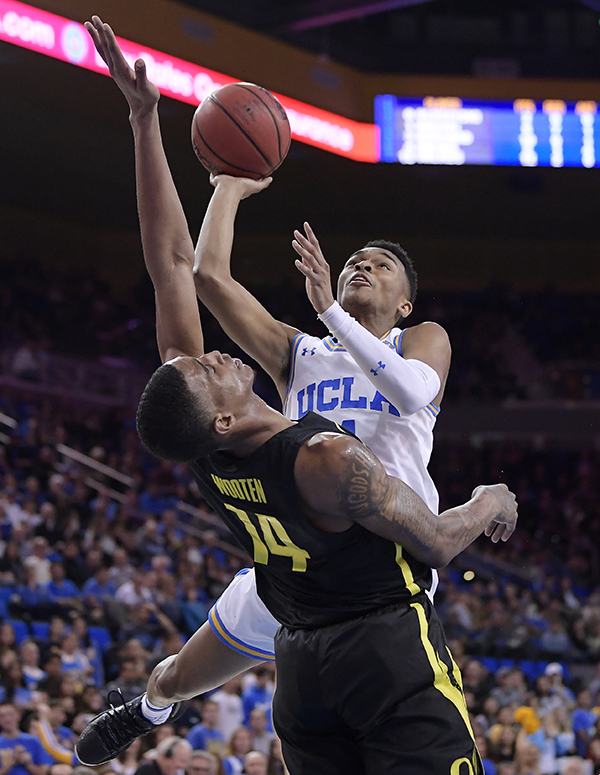 0439e87b1 UCLA guard Jaylen Hands, top, shoots as Oregon forward Kenny Wooten defends  during the second half of an NCAA college basketball game Saturday, Feb.